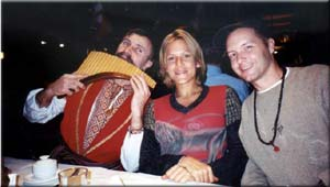 Anna Peters, Daren Friesen and one of the Ukrainian musicians at Hutoruk, a floating restaurant on the Dnipro River in Kie